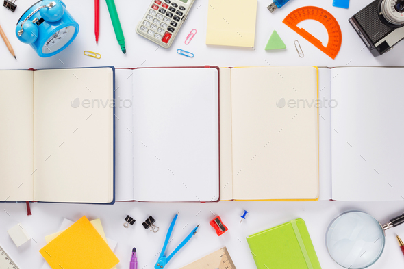 school accessories and open notebook - Stock Photo - Images