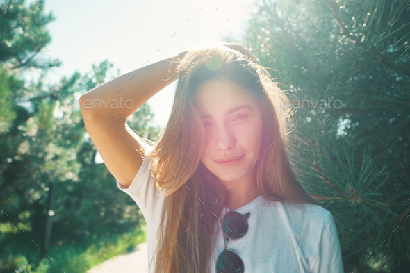 Close-up young woman with beautiful face features enjoying sun - Stock Photo - Images