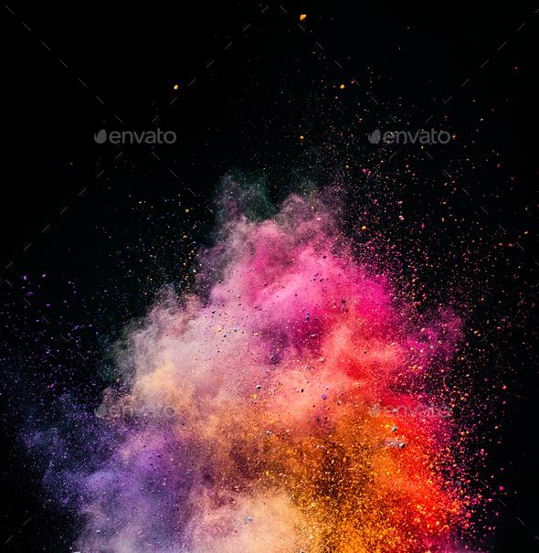 Holi powder exploding on black background