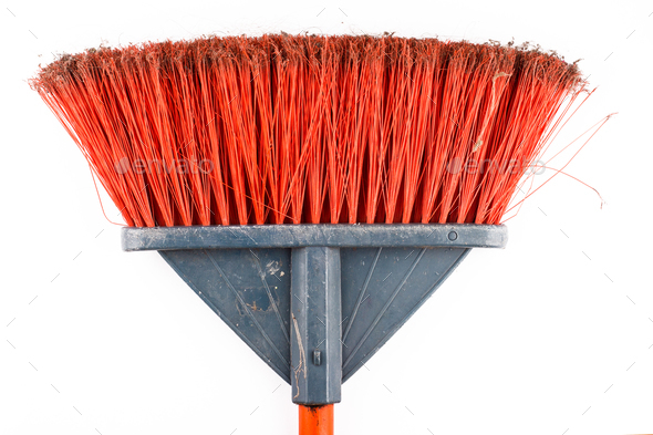 closeup of dirty sweeping broom on white background - Stock Photo - Images