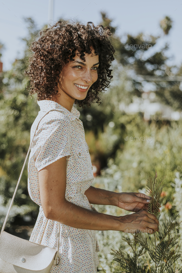 Beautiful woman in a garden - Stock Photo - Images