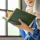 Muslim woman reading from the quran - PhotoDune Item for Sale