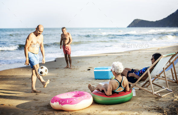 Senior friends enjoying the beach in the summertime - Stock Photo - Images