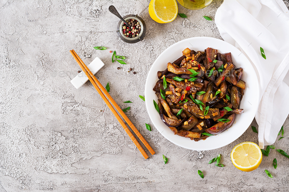 Hot spicy stew eggplant in Korean style with green onion. Aubergine saute. - Stock Photo - Images