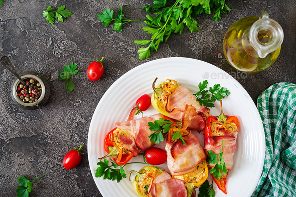 Stuffed peppers with cottage cheese and bacon in plate on the  table. Balkan food. - Stock Photo - Images