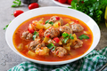 Hot stew tomato soup with meatballs and vegetables closeup in a bowl on the table.  - PhotoDune Item for Sale