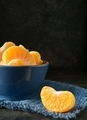 A blue bowl of orange tangerine segments - PhotoDune Item for Sale