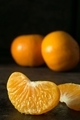 A close up of a juicy segment of an orange tangerine - PhotoDune Item for Sale