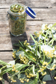 Jar with Linden blossom on wooden table. - PhotoDune Item for Sale