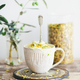Pistachio ice cream with pistachio nuts in mug, selective focus - PhotoDune Item for Sale