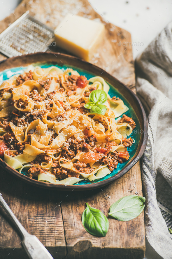 Italian traditional pasta dinner with tagliatelle bolognese and tomato sauce - Stock Photo - Images