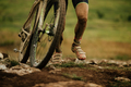 dirty feet cyclist uphill walk - PhotoDune Item for Sale