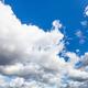low cumulus clouds in dark blue sky in september - PhotoDune Item for Sale
