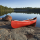 Red canoe on rocky shore of Boundary Waters lake in northern Minnesota - PhotoDune Item for Sale