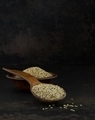 A wooden spoon and bowl of sesame seeds - PhotoDune Item for Sale