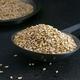 Sesame seeds in a metal scoop  - PhotoDune Item for Sale