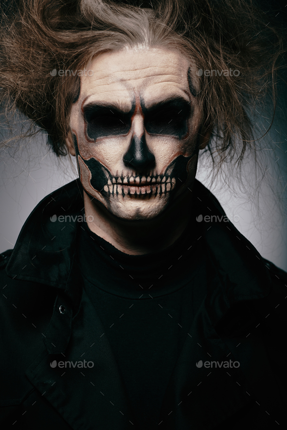 Skull makeup portrait of young man. Halloween face art. - Stock Photo - Images