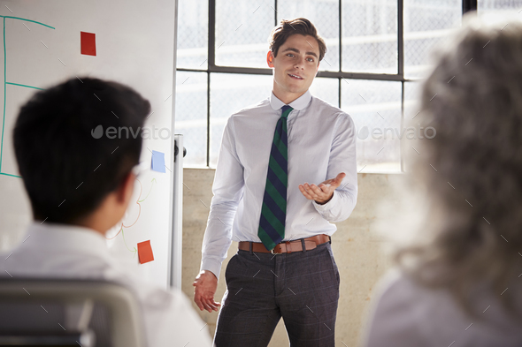 Young white businessman giving a presentation, close up - Stock Photo - Images