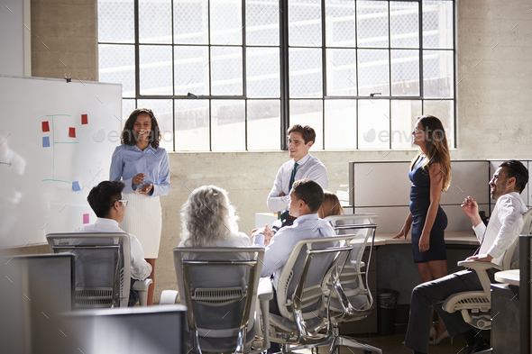 Female manager and colleagues at a brainstorm meeting - Stock Photo - Images