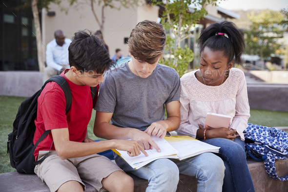 Group Of High School Students Studying Outdoors During Recess - Stock Photo - Images