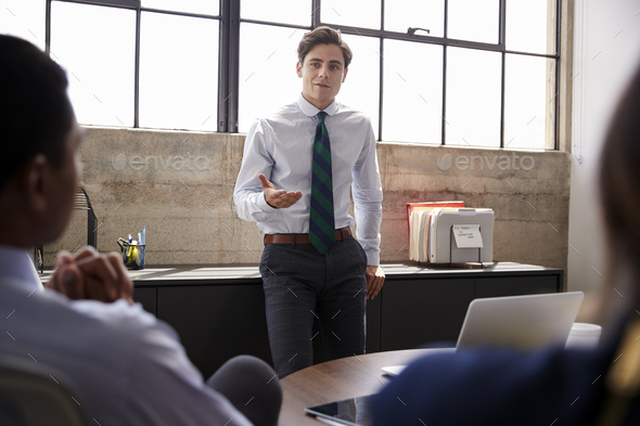 Young male manager addressing team at a meeting, close up - Stock Photo - Images