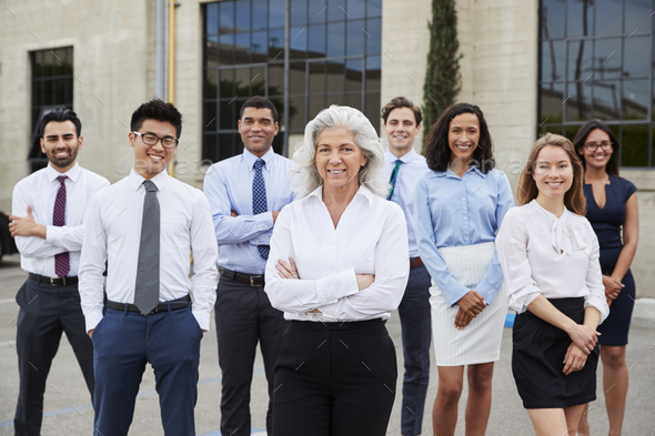 Senior businesswoman and colleagues outdoors, portrait - Stock Photo - Images