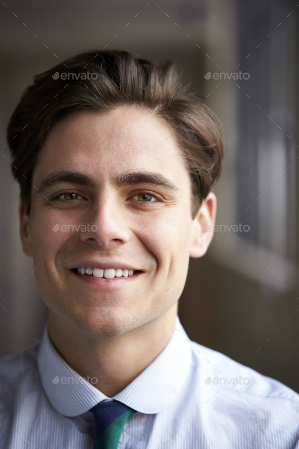 Close up head and shoulders of young white businessman - Stock Photo - Images