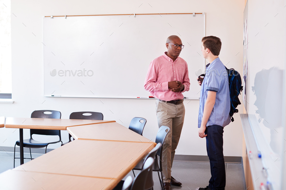 High School Tutor Talking With Male Student After Class - Stock Photo - Images