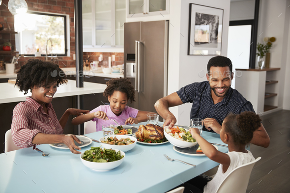 Family Enjoying Meal Around Table At Home Together - Stock Photo - Images