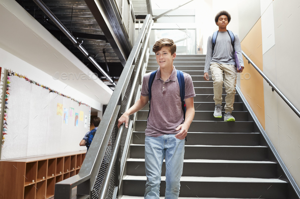 High School Students Walking Down Stairs In Busy College Building - Stock Photo - Images
