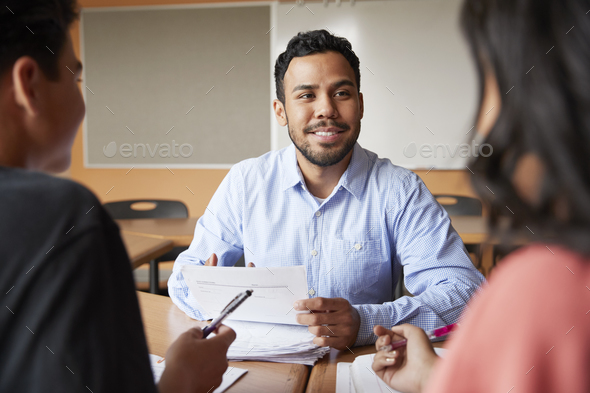 Male High School Tutor With Two Students At Desk In Seminar - Stock Photo - Images