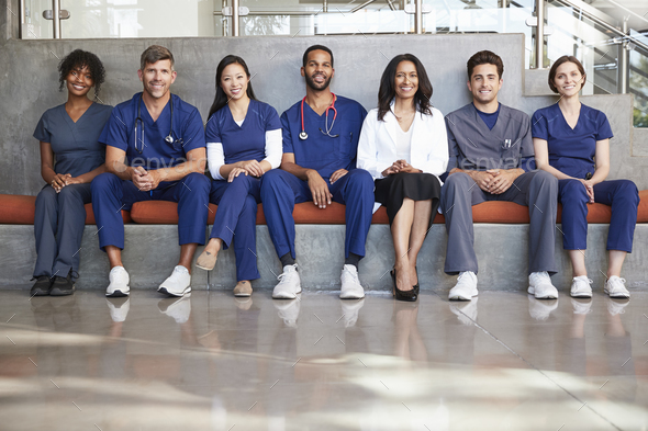 Healthcare workers sitting in a modern hospital, low angle - Stock Photo - Images