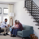 Senior Couple Meeting With Male Financial Advisor At Home - PhotoDune Item for Sale