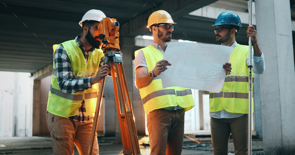 Architect consult engineer on construction site - Stock Photo - Images