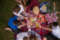 top view of group friends enjoying picnic time - PhotoDune Item for Sale