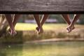 people sitting at wooden bridge - PhotoDune Item for Sale