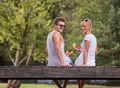 couple enjoying watermelon while sitting on the wooden bridge - PhotoDune Item for Sale