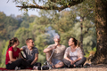 friends smoking hookah on the river bank - PhotoDune Item for Sale