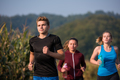 young people jogging on country road - PhotoDune Item for Sale