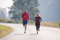 young couple jogging along a country road - PhotoDune Item for Sale