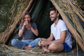couple spending time together in straw tent - PhotoDune Item for Sale