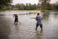 young men having fun with water guns - PhotoDune Item for Sale
