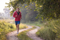 man jogging along a country road - PhotoDune Item for Sale