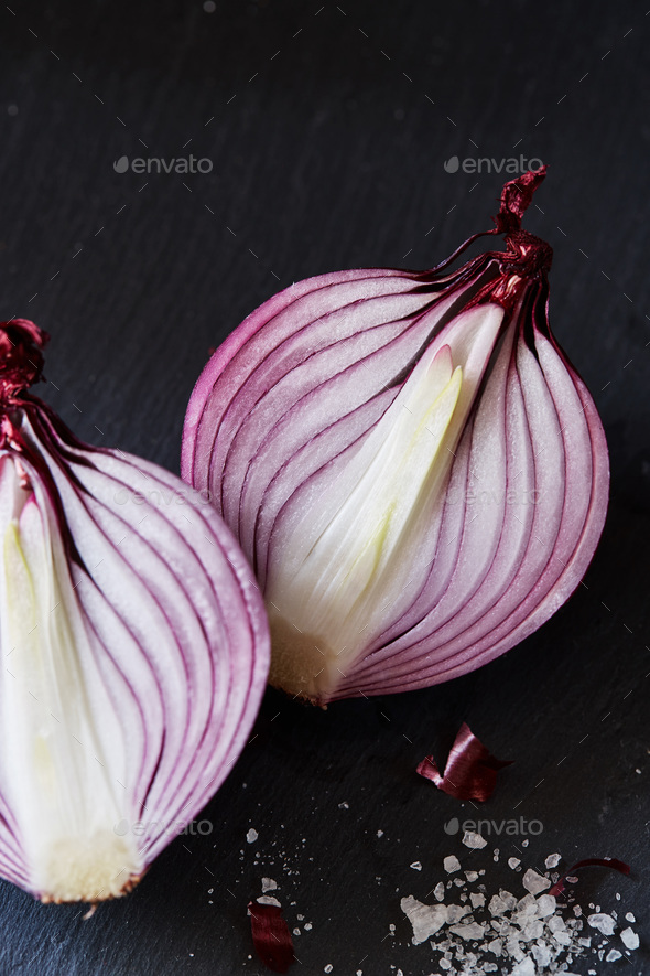 Sliced red spanish onion with and sea salt - Stock Photo - Images