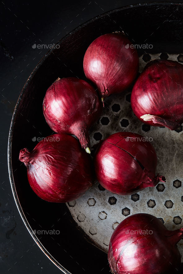 Sliced red spanish onion on vintage frying pan - Stock Photo - Images