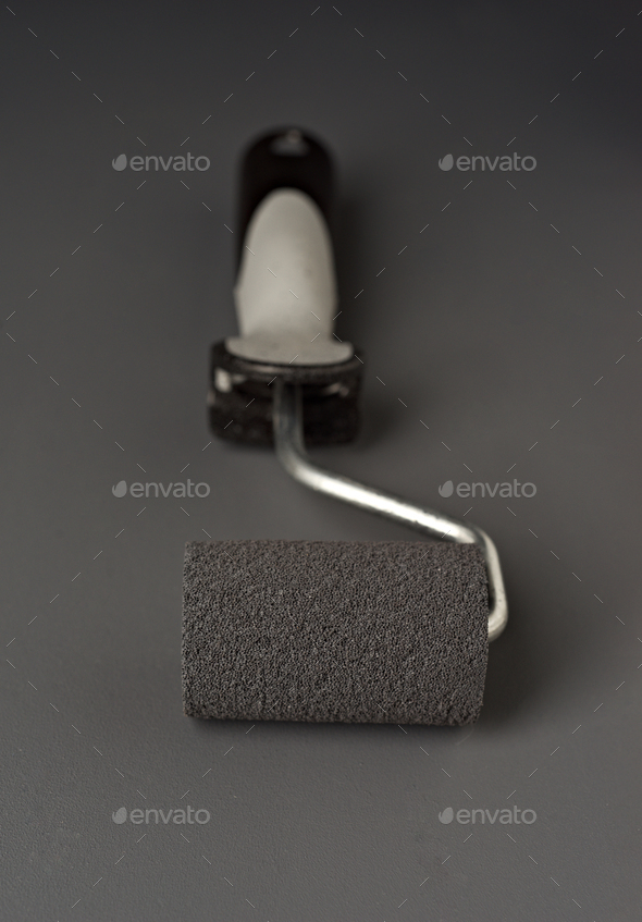 paint roller on gray background - Stock Photo - Images
