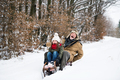 Grandfather and small girl sledging on a winter day. - PhotoDune Item for Sale