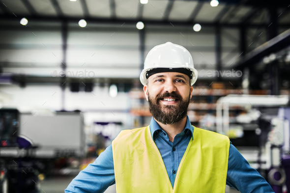 A portrait of an industrial man engineer in a factory. - Stock Photo - Images