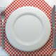 Top view of clean white plate with fork and knife on a tableclot - PhotoDune Item for Sale