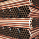 Copper or bronze metal pipes in warehouse. Heavy non-ferrous met - PhotoDune Item for Sale